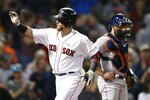 Boston Red Sox's Christian Vazquez, left, celebrates his solo home run in front of Houston Astros' Max Stassi during the fourth inning of a baseball game in Boston, Saturday, May 18, 2019. (AP Photo/Michael Dwyer)