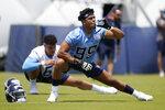 Tennessee Titans linebacker Rashad Weaver (99) stretches during NFL football rookie minicamp Saturday, May 15, 2021, in Nashville, Tenn. (AP Photo/Mark Humphrey, Pool)