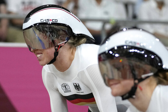 Emma Hinze, left, and Lea Sophie Friedrich of Germany compete during the track cycling women's team sprint qualifying heat at the 2020 Summer Olympics, Monday, Aug. 2, 2021, in Izu, Japan. (AP Photo/Christophe Ena)