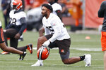 Cleveland Browns defensive end Myles Garrett (95) warms up during an NFL football practice at the team's training facility Wednesday, June 2, 2021, in Berea, Ohio. (AP Photo/Ron Schwane)