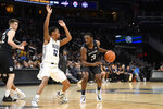 Butler guard Kamar Baldwin (3) dribbles the ball next to Georgetown guard Terrell Allen (12) during the first half of an NCAA college basketball game, Tuesday, Jan. 28, 2020, in Washington. (AP Photo/Nick Wass)