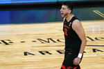 Oregon State's Roman Silva (12) reacts after a play against UCLA during the second half of an NCAA college basketball game in the quarterfinal round of the Pac-12 men's tournament Thursday, March 11, 2021, in Las Vegas. (AP Photo/John Locher)