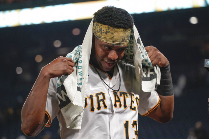 Pittsburgh Pirates' Ke'Bryan Hayes wipes his head after being doused by teammates after he drove in the winning run in the team's baseball game against the Washington Nationals, Friday, Sept. 10, 2021, in Pittsburgh. The Pirates won 4-3. (AP Photo/Keith Srakocic)