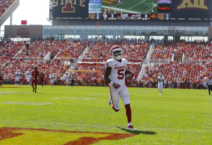 Oklahoma wide receiver Marquise Brown runs in for a touchdown during the first half of an NCAA college football game against Iowa State, Saturday, Sept. 15, 2018, in Ames, Iowa. (AP Photo/Matthew Putney)
