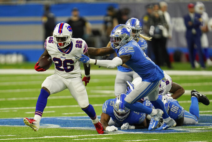 Buffalo Bills running back Devin Singletary (26) is stopped by Detroit Lions defensive back Tracy Walker (21) during the first half of a preseason NFL football game, Friday, Aug. 13, 2021, in Detroit. (AP Photo/Paul Sancya)