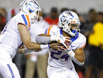 Boise State quarterback Chase Cord hands the ball to running back George Holani during the first half of an NCAA college football game against UNLV, Saturday, Oct. 5, 2019, in Las Vegas. (AP Photo/John Locher)