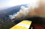 In this Wednesday, Nov. 13, 2019 photo provided from the Cyprus Forest Department, showing smoke from a forest fire, in Akamas Peninsula. Cyprus' president is vowing to go ahead with creating a national park in a largely untouched area of the tourism-reliant island, following a string of deliberately-set forest fires that were blamed on local landowners' development plans. (Cyprus Forest Department via AP)