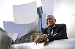 """Horace Bowers, 93, owner of Bowers & Sons Cleaners in Los Angeles and a subject of the Oscar-nominated documentary short film """"A Concerto is a Conversation,"""" poses for a portrait outside Walt Disney Concert Hall, Thursday, April 15, 2021, in Los Angeles. (AP Photo/Chris Pizzello)"""