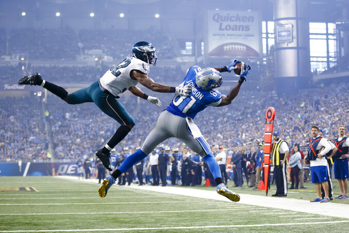 FILE - In this Nov. 26, 2015, file photo, Detroit Lions wide receiver Calvin Johnson (81), defended by Philadelphia Eagles cornerback Eric Rowe (32) , catches a pass for a touchdown during the second half of an NFL football game, in Detroit. Calvin Johnson is a 2021 finalist for entry into the Pro Football Hall of Fame. (AP Photo/Rick Osentoski, File)