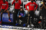Atlanta Hawks guard Trae Young (11) sits on the bench during the first half of Game 4 of the team's NBA basketball Eastern Conference finals against the Milwaukee Bucks on Tuesday, June 29, 2021, in Atlanta. (AP Photo/Brynn Anderson)
