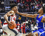 Mississippi guard Breein Tyree (4) is fouled by Middle Tennessee guard Jayce Johnson (13) during an NCAA college basketball game in Oxford, Miss. on Saturday, Dec. 14, 2019. (Bruce Newman/The Oxford Eagle via AP)