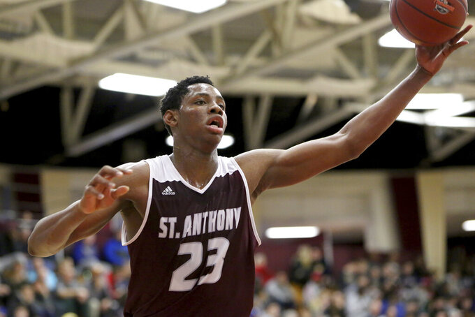 In this Jan. 14, 2017, St. Anthony's Charles Bassey (23) in action against Hudson Catholic during a high school basketball game at the 2017 Hoophall Classic in Springfield, MA. Bassey was having a productive freshman season last year while watching Morant rise to stardom about 100 miles away. Bassey enters this season as one of the top pro prospects from any college that isn't in a major conference or in the preseason Top 25. (AP Photo/Gregory Payan)
