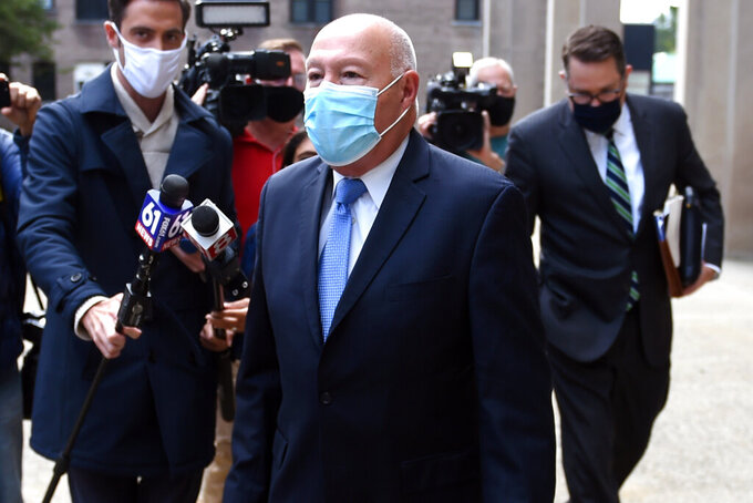 """FILE — In this Oct.5, 2020 file photo, former Bridgeport Police Chief Armando """"A.J."""" Perez leaves Federal Court, in Bridgeport, Conn., after pleading guilty to defrauding the city and making false statements to FBI agents.  Perez says in court documents filed Monday, March 30, 2021,  that he has taken full responsibility, is now suffering financial hardship and is susceptible to serious COVID-19 complications. Perez is asking for home confinement, probation and to pay nearly $300,000 in restitution.(Brad Horrigan/Hartford Courant via AP)"""