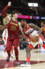 Washington Wizards' John Wall (2) drives against Cleveland Cavaliers' Cedi Osman (16) during the second half of an NBA basketball game Saturday, Dec. 8, 2018, in Cleveland. The Cavaliers won 116-101. (AP Photo/Tony Dejak)