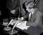FILE - In this Oct. 7, 1963, file photo, President John F. Kennedy signs the Limited Test Ban Treaty during a ratification ceremony in the White House Treaty Room in Washington. Nuclear disarmament might seem like a must-discuss topic in world leaders' annual speeches at the U.N. General Assembly, which has espoused that cause since its founding. And the assembly's big annual meeting this Sept. 2021, came in a year that marked the entry into force of one nuclear weapons treaty and the anniversary of another.  (AP Photo/File)