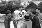 FILE - Alabama All-America receiver Ray Perkins signs autograph during a photo session at Tulane Stadium in New Orleans, La., in this Dec. 30, 1966, file photo. Perkins, who replaced Hall of Famer Bear Bryant as Alabama's football coach and started the transition with the New York Giants that led to two Super Bowl titles, died Wednesday morning, Dec. 9, 2020, in Tuscaloosa. He was 79. The school announced his passing on Wednesday, and daughter Rachael Perkins posted news of his death on her Facebook page. (AP Photo/File)
