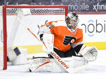 FILE - In this April 6, 2021, file photo, Philadelphia Flyers goaltender Carter Hart guards the net during an NHL hockey game against the Boston Bruins in Philadelphia. The Flyers re-signed Hart to a three-year, $11.9 million contract Monday, Aug. 9, 2021. (AP Photo/Derik Hamilton, File)