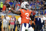 Virginia quarterback Bryce Perkins (3) stands back to pass during the first half of the Orange Bowl NCAA college football game against Florida, Monday, Dec. 30, 2019, in Miami Gardens, Fla. (AP Photo/Lynne Sladky)