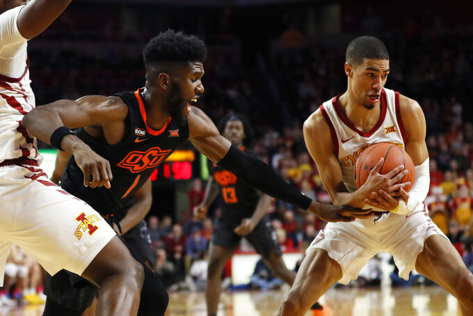 Iowa State guard Tyrese Haliburton, right, steals the ball from Oklahoma State guard Jonathan Laurent, left, during the second half of an NCAA college basketball game, Tuesday, Jan. 21, 2020, in Ames, Iowa. Iowa State won 89-82. (AP Photo/Charlie Neibergall)