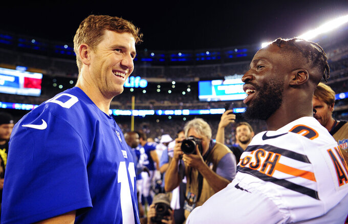 New York Giants quarterback Eli Manning (10) greets Chicago Bears cornerback Prince Amukamara (20) after a preseason NFL football game, Friday, Aug. 16, 2019, in East Rutherford, N.J. The Giants won 32-13.(AP Photo/Sarah Stier)