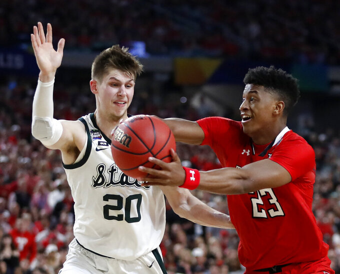 Texas Tech's Jarrett Culver (23) drives against Michigan State's Matt McQuaid (20) during the first half in the semifinals of the Final Four NCAA college basketball tournament, Saturday, April 6, 2019, in Minneapolis. (AP Photo/Jeff Roberson)