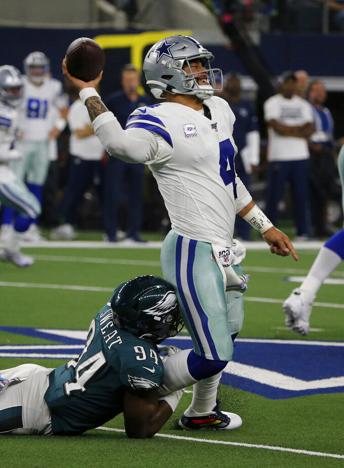 Philadelphia Eagles defensive end Josh Sweat (94) pressures Dallas Cowboys quarterback Dak Prescott (4) before Prescott threw a pass in the first half of an NFL football game in Arlington, Texas, Sunday, Oct. 20, 2019. (AP Photo/Michael Ainsworth)