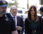 FILE - In this July 11, 2019 file photo, Harvey Weinstein, left, and attorney Donna Rotunno arrive at court for a hearing related to his sexual assault case in New York. Weinstein is set to go on trial Monday, Jan. 6, 2020 more than two years after a torrent of women began accusing him of misconduct. (AP Photo/Seth Wenig, File)