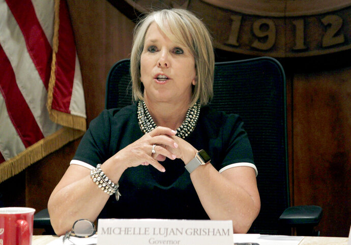 FILE - In this July 9, 2019 file photo, New Mexico Gov. Michelle Lujan Grisham speaks during a news conference in Santa Fe, N.M. An advocacy group for retired public employees assailed core provisions of a pension reform proposal in defiance of recommendations by the governor, at a legislative hearing Wednesday, Dec. 4, 2019. (AP Photo/Susan Montoya Bryan, File)