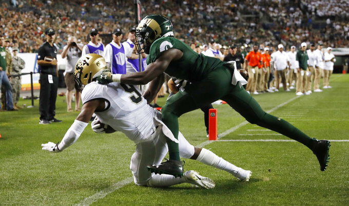 Colorado wide receiver Juwann Winfree, left, pulls in a pass for a touchdown as Colorado State cornerback Rashad Ajayi defends in the first half of an NCAA college football game Friday, Aug. 31, 2018, in Denver. (AP Photo/David Zalubowski)