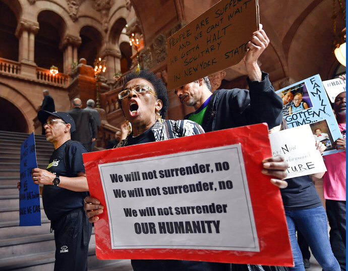 Nathylin Flowers marches with protesters against solitary confinement at New York state correctional facilities, during a rally to urge New York state legislators to pass reform legislation at the state Capitol Wednesday, June 19, 2019, in Albany, N.Y. (AP Photo/Hans Pennink)