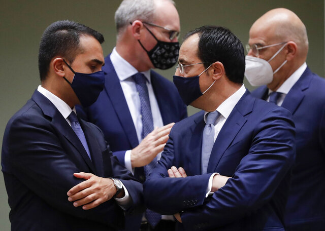 Cypriot Foreign Minister Nicos Christodoulides, second right, speaks with Italy's Foreign Minister Luigi Di Maio, left, during a meeting of EU foreign affairs ministers at the European Council building in Brussels, Monday, Sept. 21, 2020. European Union foreign ministers on Monday were weighing whether to impose sanctions on dozens of Belarus officials, including President Alexander Lukashenko, after holding talks with the country's exiled opposition leader. (Olivier Hoslet, Pool via AP)