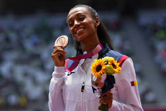 Ana Peleteiro, of Spain, holds up her bronze medal for the women's triple jump at the 2020 Summer Olympics, Monday, Aug. 2, 2021, in Tokyo. (AP Photo/Francisco Seco)