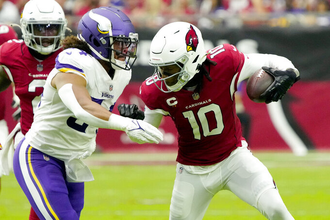 Arizona Cardinals wide receiver DeAndre Hopkins (10) tries to elude the tackle of Minnesota Vikings middle linebacker Eric Kendricks during the first half of an NFL football game, Sunday, Sept. 19, 2021, in Glendale, Ariz. (AP Photo/Rick Scuteri)