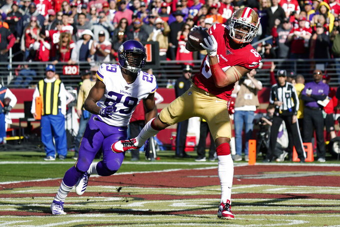 San Francisco 49ers wide receiver Kendrick Bourne, right, catches a pass to score a touchdown in front of Minnesota Vikings cornerback Xavier Rhodes (29) during the first half of an NFL divisional playoff football game, Saturday, Jan. 11, 2020, in Santa Clara, Calif. (AP Photo/Tony Avelar)