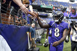 FILE - In this Sept. 29, 2019, file photo, Baltimore Ravens quarterback Lamar Jackson acknowledges fans prior to an NFL football game against the Cleveland Browns in Baltimore. All those home-field advantages seen across the league, like Baltimore, Denver, Green Bay, New Orleans, Pittsburgh and Seattle, could be mostly wiped out by the coronavirus pandemic in 2020.  (AP Photo/Brien Aho, File)