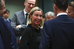 European Union foreign policy chief Federica Mogherini, center, arrives for a European Foreign Affairs Ministers meeting at the European Council headquarters in Brussels, Monday, July 15, 2019. European Union nations were looking to deescalate tensions in the Persian Gulf area on Monday and call on Iran to stick to the 2015 nuclear deal, despite the pullout of the United States from the accord and the re-imposition of U.S. sanctions on Tehran. (AP Photo/Francisco Seco)