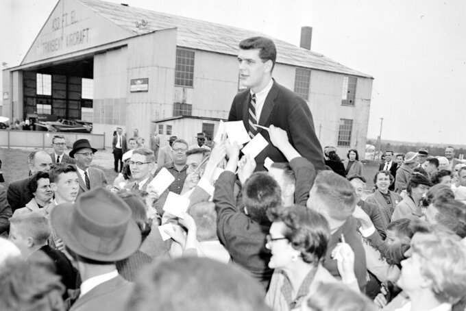 FILE - In this March 24, 1957, file photo, North Carolina college basketball player Joe Quigg is carried by fans in Raleigh, N.C., after returning from the Final Four in Kansas City, where UNC beat Kansas 54-53 in the championship game. (AP Photo/Rudolph Faircloth, File)