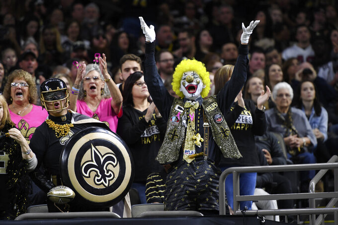 New Orleans Saints fans cheer in the first half of an NFL football game against the Arizona Cardinals in New Orleans, Sunday, Oct. 27, 2019. (AP Photo/Bill Feig)