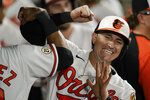 Baltimore Orioles' Austin Hays, right, is greeted in the dugout by Kelvin Gutierrez after hitting a two-run home run off New York Yankees relief pitcher Chad Green during the eighth inning of a baseball game, Wednesday, Sept. 15, 2021, in Baltimore. (AP Photo/Julio Cortez)