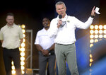 Jacksonville Jaguars coach Urban Meyer addresses the crowd, backed by offensive coordinator Darrell Bevell and assistant head coach Charlie Strong, during an NFL football draft party Thursday, April 29, 2021, in Jacksonville, Fla. (Bob Self/The Florida Times-Union via AP)