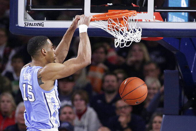 North Carolina forward Garrison Brooks (15) dunks during the second half of an NCAA college basketball game against Gonzaga in Spokane, Wash., Wednesday, Dec. 18, 2019. Gonzaga won 94-81. (AP Photo/Young Kwak)