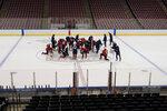 Florida Panthers players huddle on center ice during an NHL hockey training camp, Friday, Sept. 24, 2021, in Sunrise, Fla. (AP Photo/Wilfredo Lee)