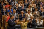 Spain's caretaker Prime Minister Pedro Sánchez, bottom and left, is applauded by Socialist party colleagues during the parliamentary debate at the Spanish parliament in Madrid, Spain, Monday, July 22, 2019. Sánchez will seek the endorsement of the Spanish Parliament on Monday ahead of this week's confidence votes for him to form a new government. (AP Photo/Bernat Armangue)