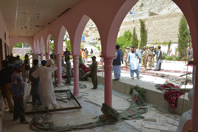 Pakistani officials examine a mosque following a bomb blast in Quetta, Pakistan, Friday, May 24, 2019. (AP Photo/Arshad Butt)