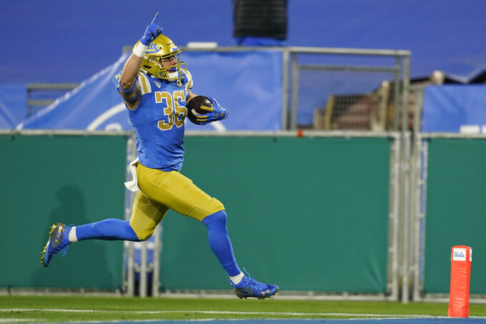 UCLA wide receiver Devanti Dillard (35) runs to the end zone for a touchdown during the first quarter of an NCAA college football game against Southern California, Saturday, Dec 12, 2020, in Pasadena, Calif. (AP Photo/Ashley Landis)