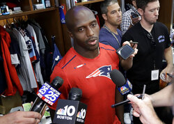 New England Patriots free safety Devin McCourty takes questions from reporters in the team's locker room following an NFL football practice, Wednesday, Sept. 11, 2019, in Foxborough, Mass. (AP Photo/Steven Senne)
