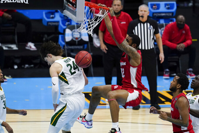 Houston forward Reggie Chaney (32) dunks the ball over Baylor guard Matthew Mayer (24) during the second half of a men's Final Four NCAA college basketball tournament semifinal game, Saturday, April 3, 2021, at Lucas Oil Stadium in Indianapolis. (AP Photo/Michael Conroy)