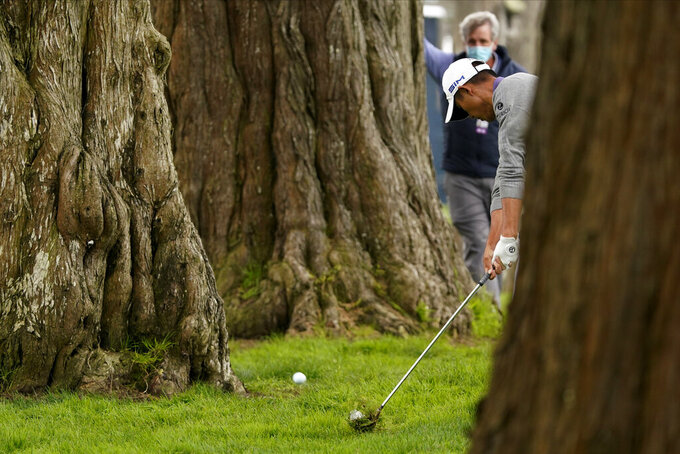 Collin Morikawa hits from the tress on the sixth hole during the final round of the PGA Championship golf tournament at TPC Harding Park Sunday, Aug. 9, 2020, in San Francisco. (AP Photo/Charlie Riedel)