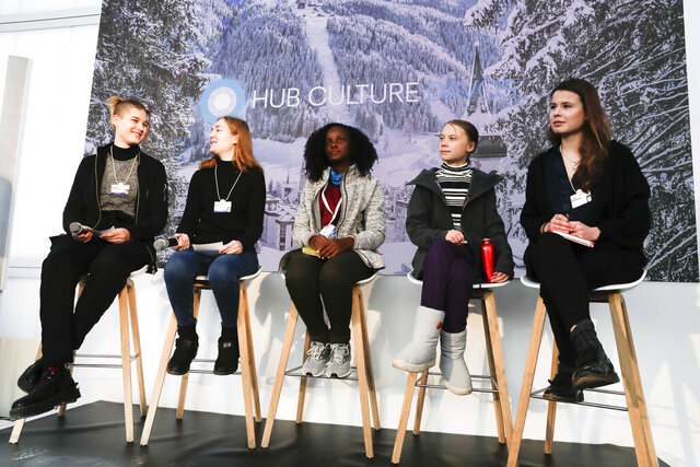 Climate activists Isabelle Axelsson, Loukina Tille, Vanessa Nakate, Greta Thunberg, and Luisa Neubaue,, from left, arrive for a news conference in Davos, Switzerland, Friday, Jan. 24, 2020. The 50th annual meeting of the forum is taking place in Davos from Jan. 21 until Jan. 24, 2020 (AP Photo/Markus Schreiber)