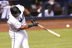 Miami Marlins' Jesus Aguilar hits a RBI-single to score Miguel Rojas during the eighth inning of a baseball game Arizona Diamondbacks, Tuesday, May 4, 2021, in Miami. The Marlins won 9-3. (AP Photo/Lynne Sladky)